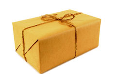 One small brown paper parcel or package tied with string isolated on white Royalty Free Stock Photo