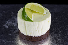 One small cake decorated with lime wedges Royalty Free Stock Image