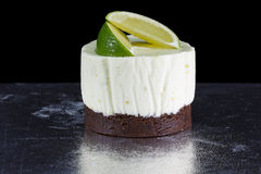 One small cake decorated with lime wedges Stock Images