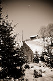 A one small house on mountain in winter forest Stock Images
