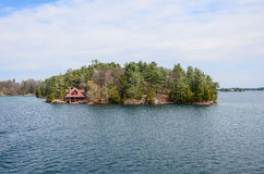 One small Island and beach house on St Lawrence river Royalty Free Stock Photos