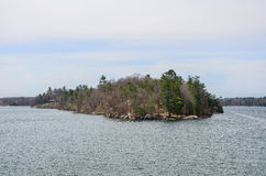 One small Island and beach house on St Lawrence river Royalty Free Stock Photo