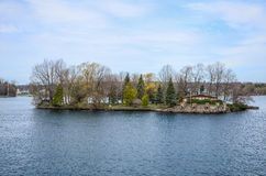 One small Island and beach house on St Lawrence river Stock Photos