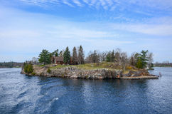 One small Island and beach house on St Lawrence river Stock Image