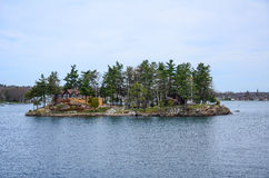 One small Island and beach house on St Lawrence river Royalty Free Stock Images