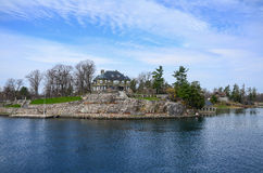 One small Island and beach house on St Lawrence river Royalty Free Stock Photography