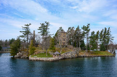 One small Island and beach house on St Lawrence river Stock Photography