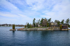 One small Island and beach house on St Lawrence river Royalty Free Stock Image