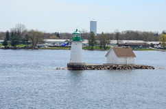 One small Island and light house on St Lawrence river Royalty Free Stock Photography