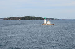 One small Island and light house on St Lawrence river Stock Photo