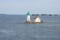 One small Island on St Lawrence river and lighthouse Stock Photo