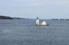 One small Island on St Lawrence river and tiny lighthouse Stock Photography