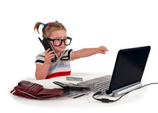 One small little girl calling phone. One small little girl wearing t-shirt. Phone, credit cards, gift cards, calculator, notebook on the table. Canadian $20 Royalty Free Stock Photos