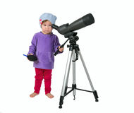 One small little girl cleaning spotting scope with air blower. Royalty Free Stock Photos