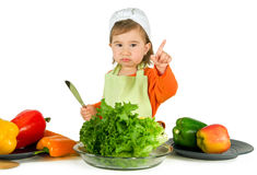 One small little girl cooking. One small little girl preparing raw fruits and vegetables for cooking. Isolated objects Stock Photography