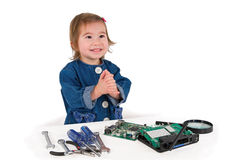 One small little girl fixing router or modem or PCB. One small little girl with set of wrench, screwdrivers, magnifying loupe repairs router or modem or PCB Stock Images