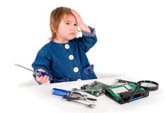One small little girl fixing router or modem or PCB. One small little girl with set of wrench, screwdrivers, magnifying loupe repairs router or modem or PCB Royalty Free Stock Photos