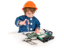 One small little girl fixing router or modem or PCB. Royalty Free Stock Photography