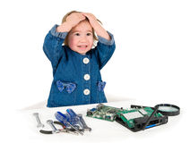 One small little girl fixing router or modem or PCB. One small little girl with set of wrench, screwdrivers, magnifying loupe repairs router or modem or PCB Royalty Free Stock Photography