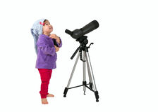 One small little girl near spotting scope and looking up. One small little girl near spotting scope on tripod looking up. Isolated object Stock Photography