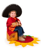 One small little girl playing guitar. One small little girl wearing sombrero, playing guitar. Isolated object Stock Image