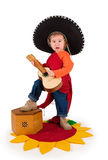 One small little girl playing guitar. One small little girl wearing sombrero, playing guitar. Isolated object Royalty Free Stock Photos
