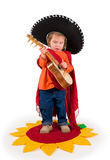 One small little girl playing guitar. One small little girl wearing sombrero, playing guitar. Isolated object Royalty Free Stock Photo
