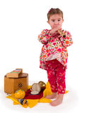One small little girl playing music. One small little girl playing on drum, flute, maraca, xylophone. Isolated onject Royalty Free Stock Photos