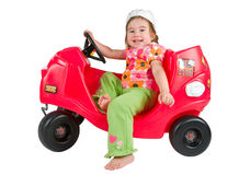 One small little girl playing with toy car. Royalty Free Stock Photos