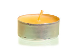 One small new candle on a white background Stock Image