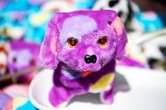 One small super cute purple colored stuffed toy dog royalty free stock photos