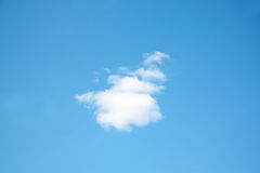 One small white cloud on light blue sky Royalty Free Stock Photo