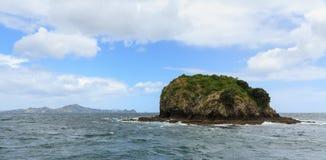A tiny island far offshore. Bay of Islands, New Zealand royalty free stock photo