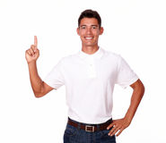 One smiling attractive adult man pointing up. Stock Images