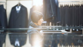 One smiling female person show emotion in big mans garment showroom stock footage