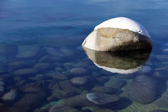 One snow covered boulder in the clean clear waters of Lake Tahoe Stock Photography
