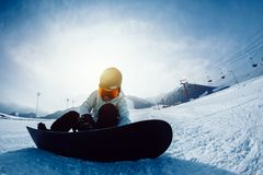 Snowboarder ready for snowboarding. One snowboarder ready for snowboarding on winter mountain top Royalty Free Stock Images