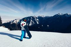 Snowboarder with snowboard on winter mountain top Stock Image