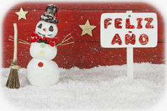 One snowmen and a signpost with the words Happy New Year on spanish Stock Photos
