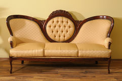 one sofa on elegant parquet Royalty Free Stock Images