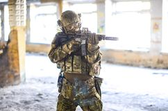 One soldier in combat gear. One soldier in urban building with M4 guns and multicam gear Royalty Free Stock Photography