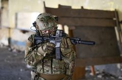 One soldier in combat gear. One soldier in urban building with M4 guns and multicam gear Stock Images