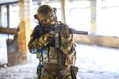 One soldier in combat gear. One soldier in urban building with M4 guns and multicam gear Stock Image