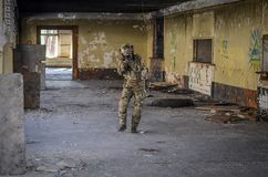 One soldier in combat gear atacking. One soldier in urban building with M4 gun and multicam gear Stock Images