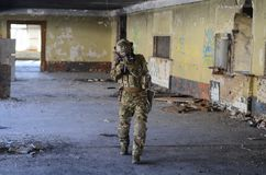 One soldier in combat gear. One soldier in urban building with M4 guns and multicam gear Royalty Free Stock Images