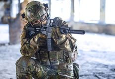 One soldier in combat gear. One soldier in urban building with M4 guns and multicam gear Stock Photo