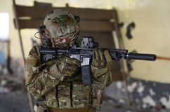 One soldier in combat gear. One soldier in urban building with M4 guns and multicam gear Stock Photos