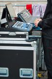 One sound technician in front of the mixers royalty free stock image