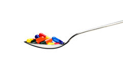 One spoon of medication over white Stock Image