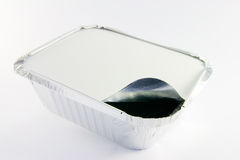 One square foil partly opened catering tray. 1 square foil partly opened catering tray on a white background Stock Photos